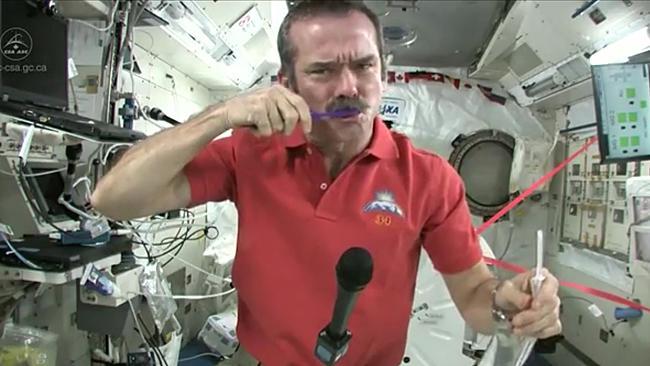 Chris Hadfield brushing teeth in space shuttle