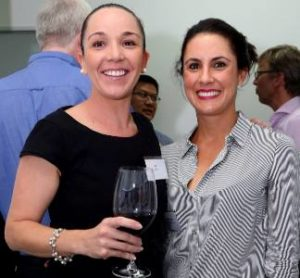 Two women smiling at ethos Toowong Opening Night