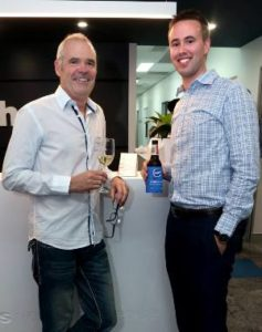 Two men smiling at ethos Toowong Opening Night