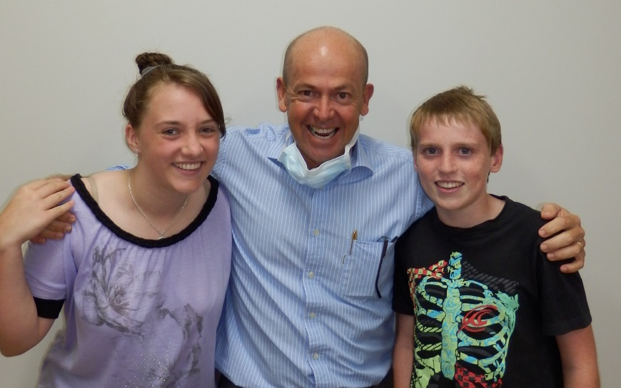 Dr Farmer with smiling patients Amy and Johnathon