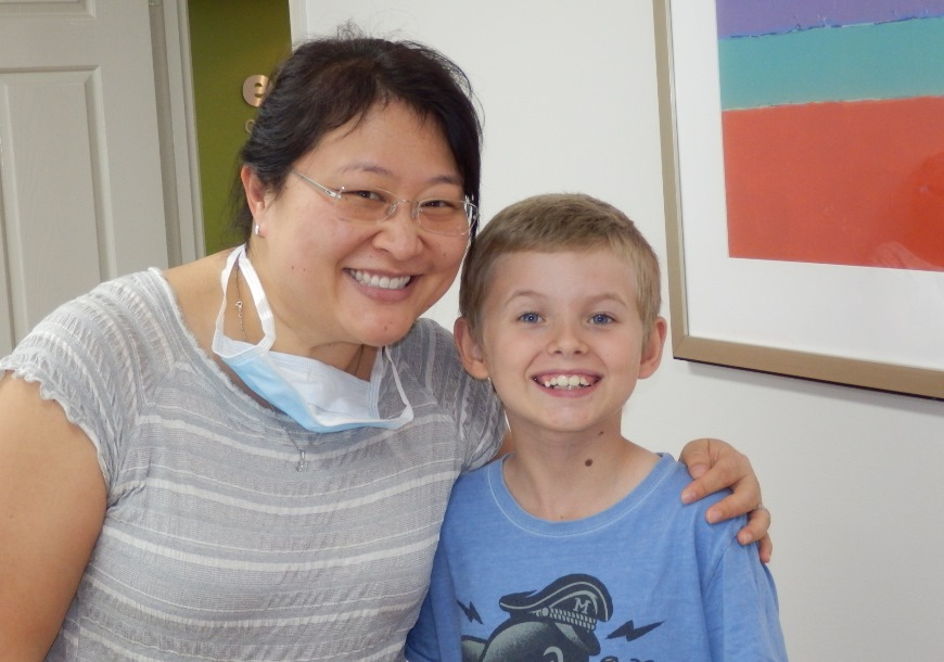 Dr Chang with smiling patient Bailey