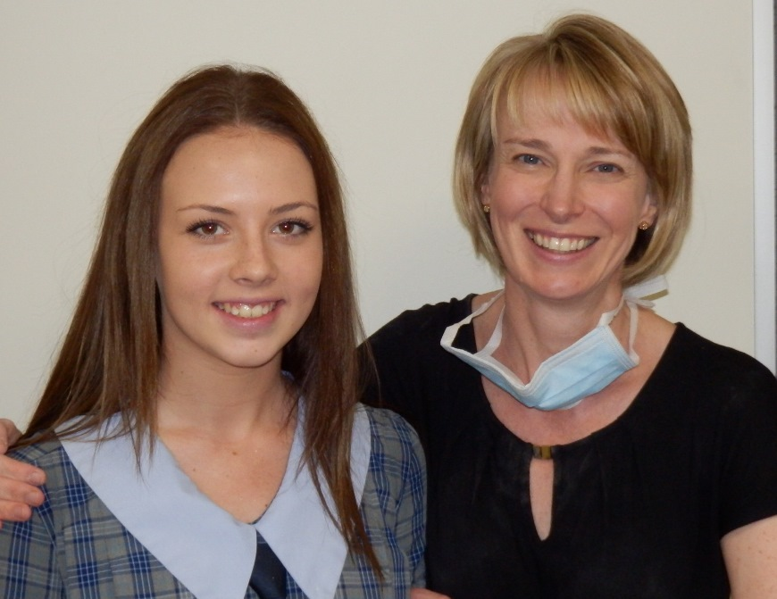 Teenage Girl smiles with Dr Prove after removal of braces at Ethos Orthodontics