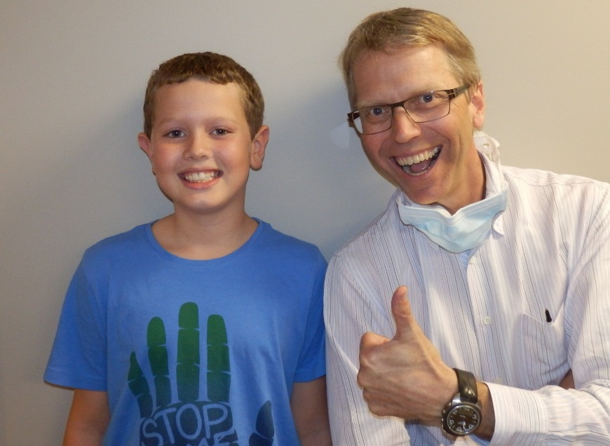 Dr Tod and patient of braces treatment smiling happily at ethos orthodontics