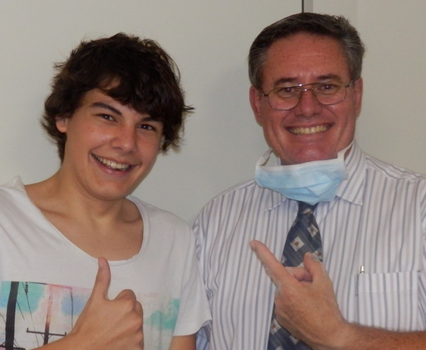 Dr Atkin with smiling orthodontics patient