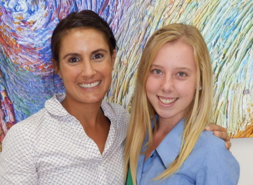 Dr Barker with smiling orthodontics patient Sam