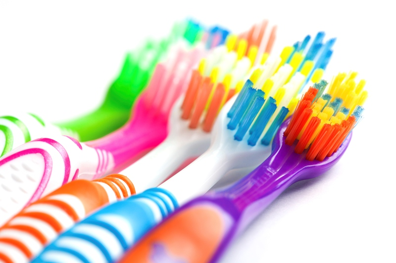 set of multicoloured toothbrushes isolated on white
