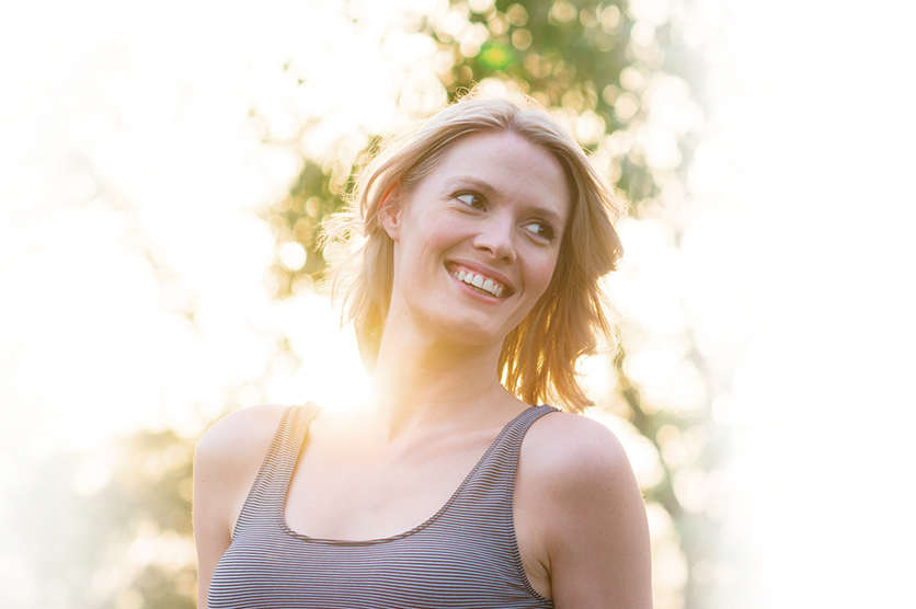 Woman smiling with the sun at her back