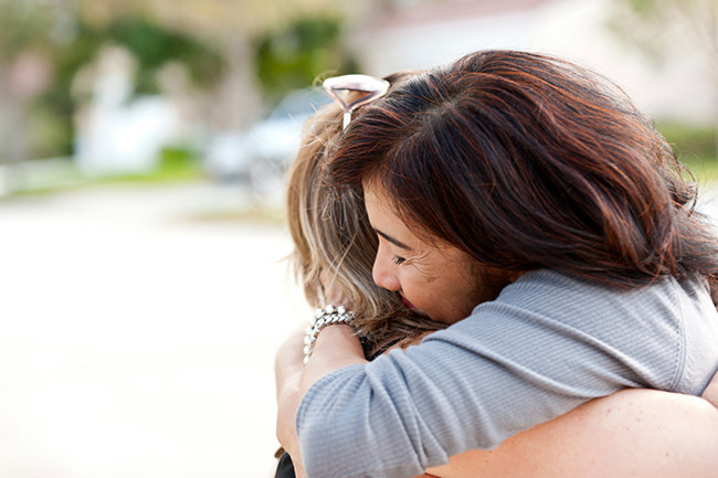 Two people embracing in a hug