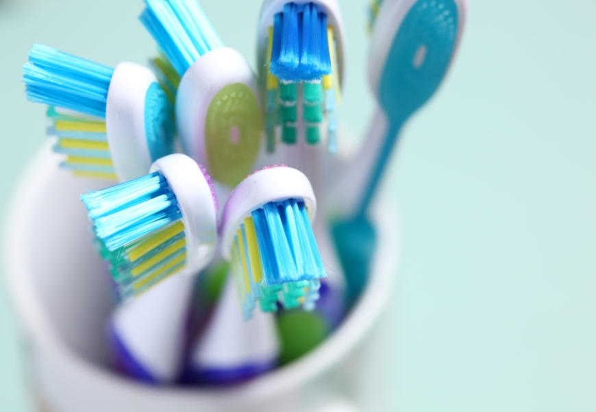 Six toothbrushes in cup