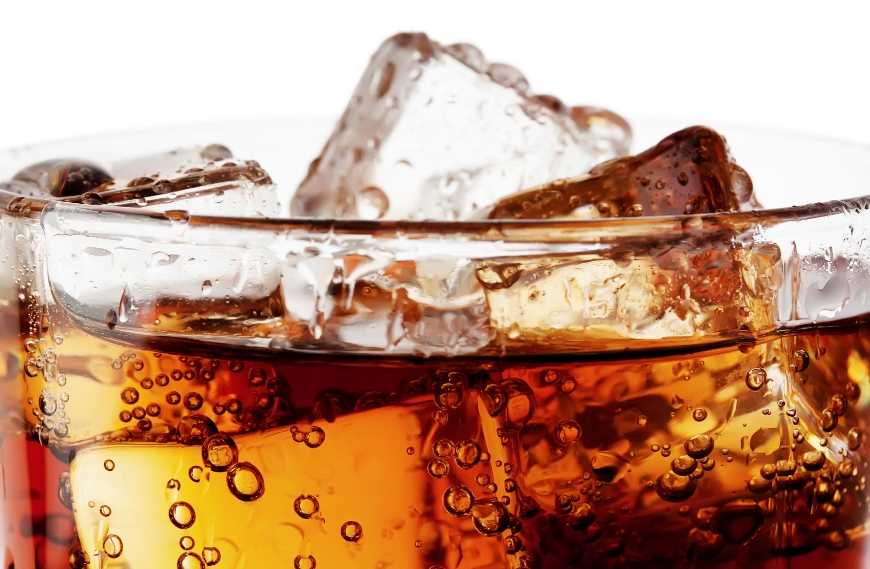 Close up of cola with ice in glass cup