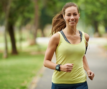 Woman with a smile running outdoors