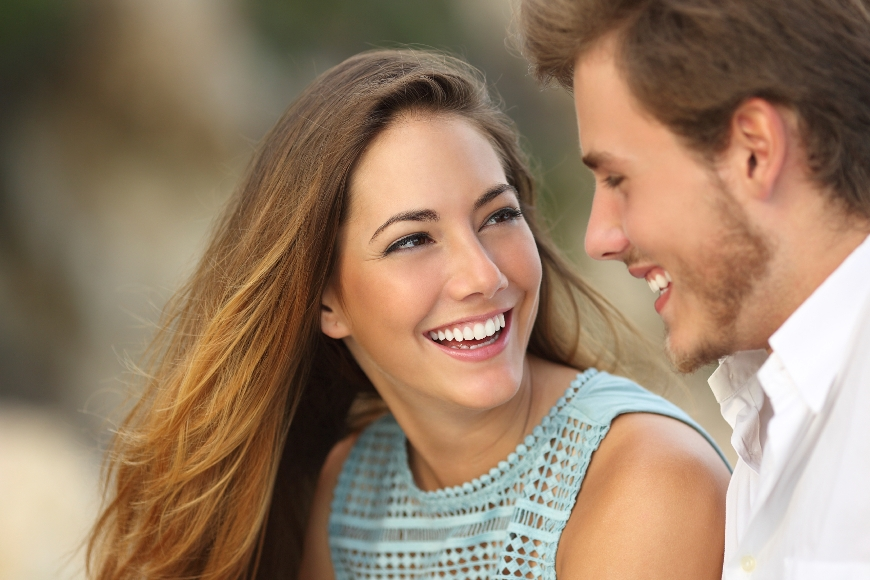 Couple laughing with a white perfect smile