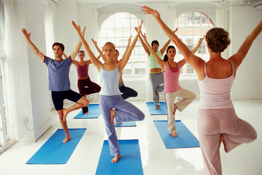 Yoga class doing a pose